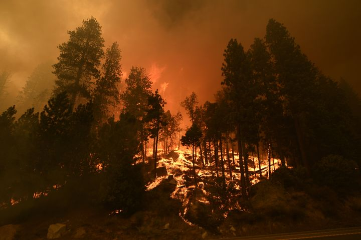 Smoke and flames rise after Caldor Fire showed a significant fire activity this afternoon along US Highway 50 near Kyburz, California, on August 26, 2021. The fire was moving towards the resort community of South Lake Tahoe.