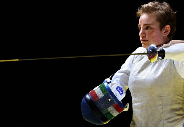 Italy's Beatrice Vio puts on her mask to compete with Russia's Ludmila Vasileva in the wheelchair fencing...