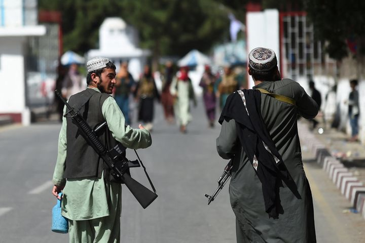Taliban fighters walk at the main entrance gate of Kabul airport in Kabul on August 28, 2021, following the Taliban stunning military takeover of Afghanistan. (Photo by WAKIL KOHSAR / AFP) (Photo by WAKIL KOHSAR/AFP via Getty Images)