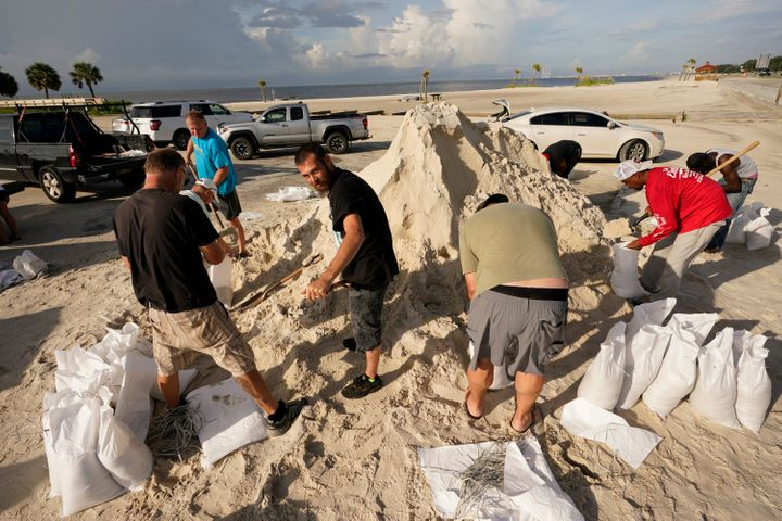 Local residents fill sand bags as they prepare for the expected arrival of Hurricane Ida Saturday, Aug. 28, 2021, in Gulfport, Miss.