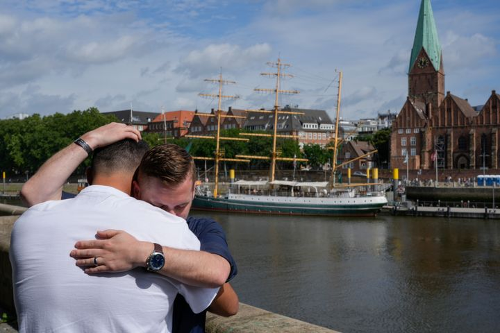 U.S. Army veteran Spencer Sullivan, right, and Abdulhaq Sodais, who served as a translator in Afghanistan, both hug and cry during an interview in Bremen, Germany, on Aug. 14.