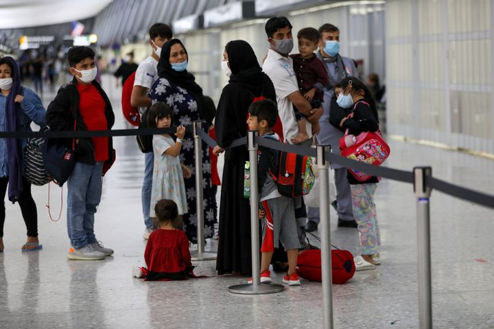 Afghan refugees evacuated from Kabul, arrive in Washington Dulles International Airport in Washington, DC, on Aug. 27.