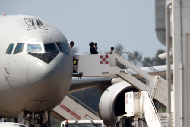 Afghan people disembark from a plane at Fiumicino Airport in Rome, Italy, August 19, 2021. REUTERS/Guglielmo Mangiapane
