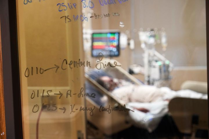 Medical notations are written on a window of a COVID-19 patient's room in an intensive care unit at the Willis-Knighton Medic