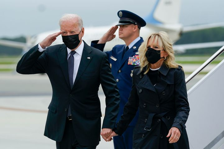President Joe Biden returns a salute as he and first lady Jill Biden arrive at Dover Air Force Base in Delaware on Sunday where they honored and mourned the 13 U.S. troops killed in a suicide attack near the Kabul airport.
