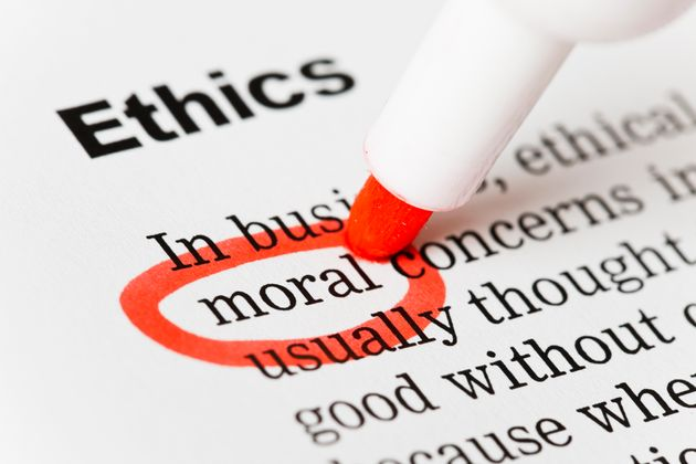 A red marker circles the word 'moral' in a document headed Ethics. Shot with Canon EOS 1Ds Mark III.