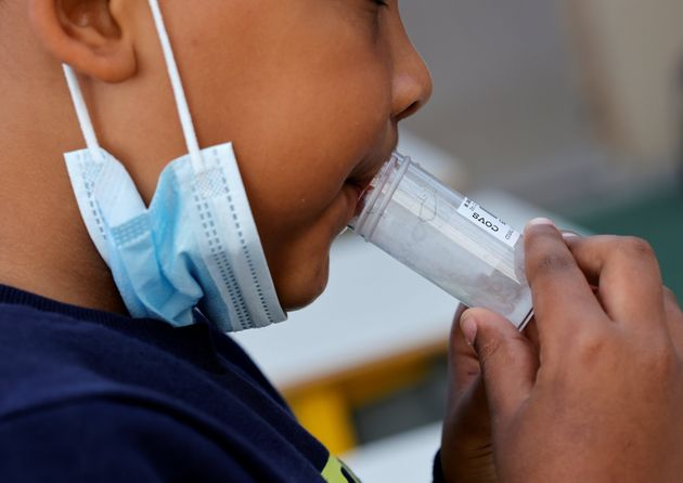 A schoolboy gives a sample during a COVID-19 saliva test in a primary school in Nice, as part of the...
