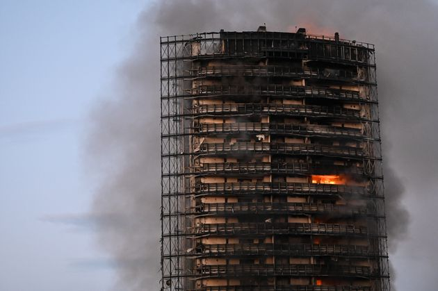 MILAN, ITALY - AUGUST 29: Flames are seen on the scene of a fire that broke out from a high residential building in the outskirts of Milan, Italy on August 29, 2021. (Photo by Piero Cruciatti/Anadolu Agency via Getty Images)