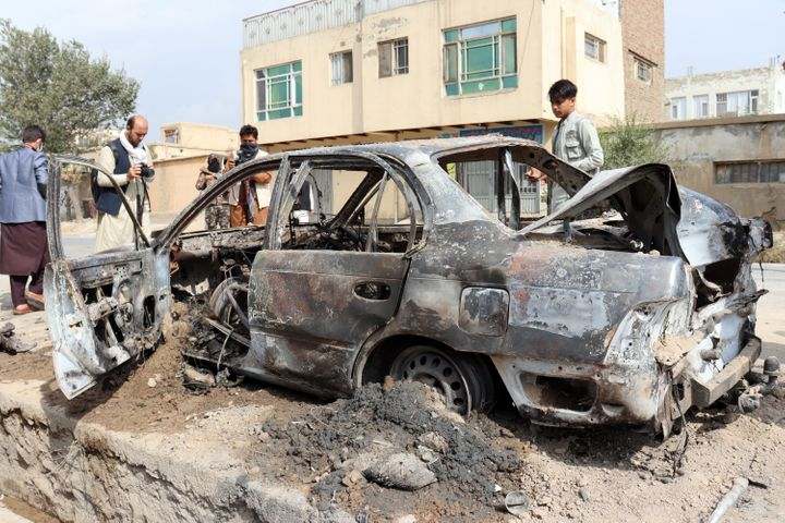 A destroyed vehicle, which contained rocket launchers, located where a rocket attack originated from in Kabul, Afghanistan, o