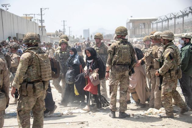 Members of the British and US military engage in the evacuation of people out of Kabul,