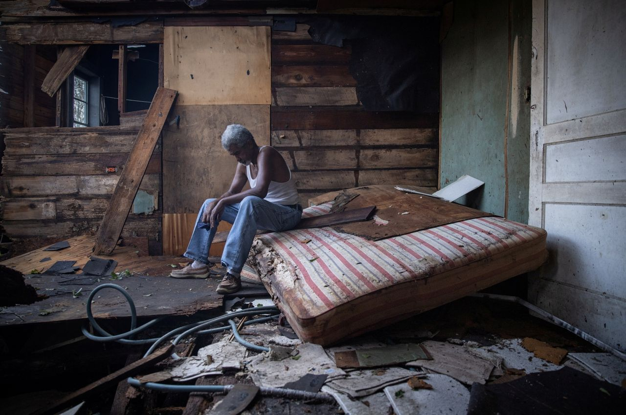 Theophilus Charles, 70, sits inside his house which was heavily damaged by Hurricane Ida in Houma, Louisiana, U.S., August 30, 2021. REUTERS/Adrees Latif TPX IMAGES OF THE DAY