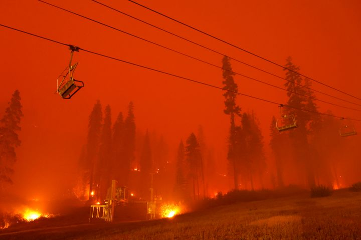 A chairlift at Sierra-at-Tahoe ski resort sits idle Monday as the Caldor fire moves through the Twin Bridges, California, area.