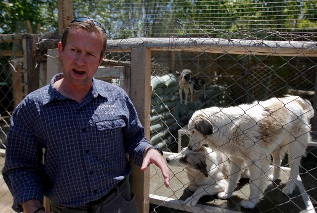 Pen Farthing, founder of British charity Nowzad, an animal shelter, stands in front of a cage on the outskirts of Kabul May 1, 2012