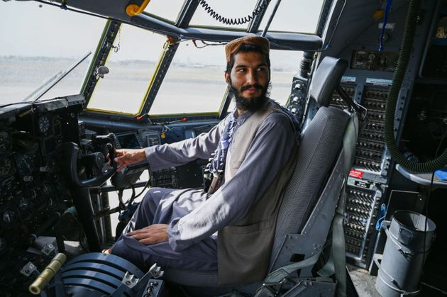 TOPSHOT - A Taliban fighter sits in the cockpit of an Afghan Air Force aircraft at the airport in Kabul on August 31, 2021, after the US has pulled all its troops out of the country to end a brutal 20-year war -- one that started and ended with the hardline Islamist in power. (Photo by Wakil KOHSAR / AFP) (Photo by WAKIL KOHSAR/AFP via Getty Images)
