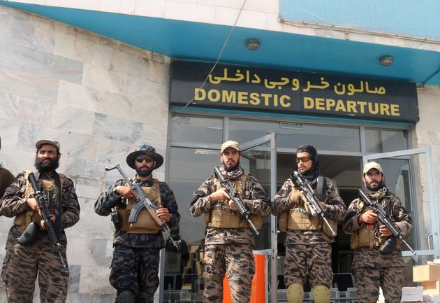 Taliban forces stand guard a day after the U.S. troops withdrawal from Hamid Karzai international airport n Kabul, Afghanistan August 31, 2021. REUTERS/Stringer NO RESALES. NO ARCHIVE