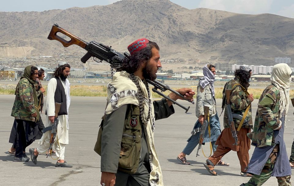 Taliban forces patrol at a runway a day after US troops withdraw from Hamid Karzai International Airport...