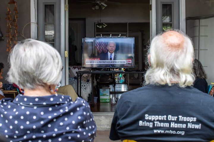 A group of military families and veterans, including a post-9/11 veteran who served in Afghanistan and the mother of a Marine who left the Kabul airport last week, gather in a Long Beach, California, home to watch President Joe Biden's speech Tuesday.