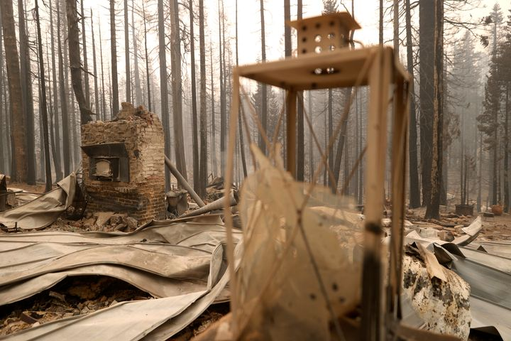 The chimney stands in the burnt remains of a home that was destroyed by the Caldor Fire on August 31, 2021 in Twin Bridges, California.