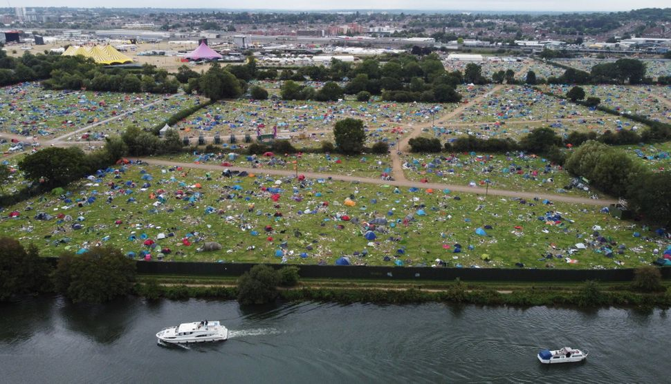 Abandoned tents are seen at the Reading Festival campsite after the event, in Reading, Britain, August 31, 2021. Picture taken with a drone. REUTERS/Matthew Childs