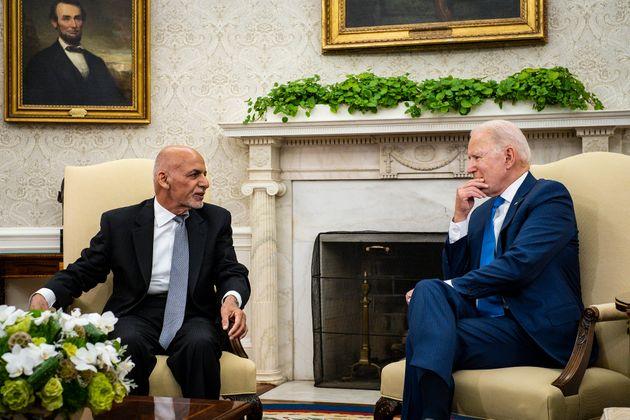 US president Joe Biden hosts then Afghanistan president Ashraf Ghani in the Oval Office at the White...