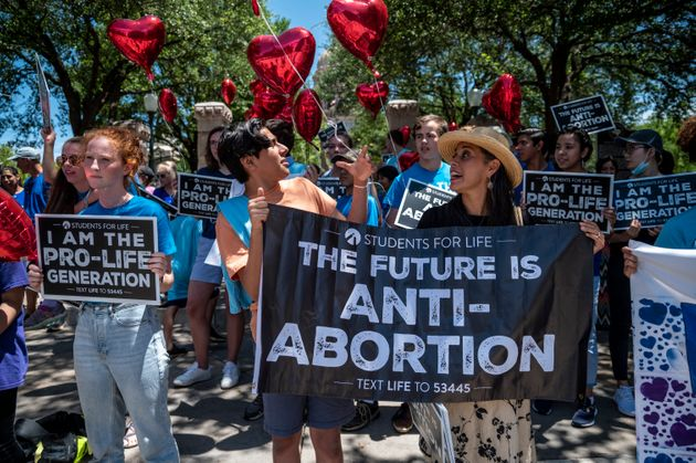 AUSTIN, TX - MAY 29: Pro-life protesters stand near the gate of the Texas state capitol at a protest outside the Texas state capitol on May 29, 2021 in Austin, Texas. Thousands of protesters came out in response to a new bill outlawing abortions after a fetal heartbeat is detected signed on Wednesday by Texas Governor Greg Abbot. (Photo by Sergio Flores/Getty Images)