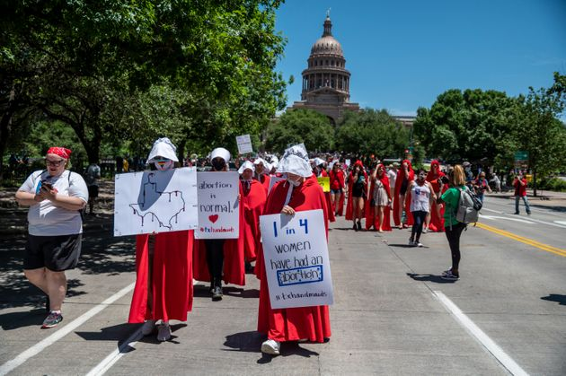 Pro-choice protesters marching in Texas against the new abortion proposals back in March, dressed as...