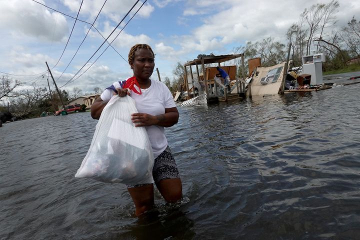 Dina Lewis rescues items from her home after it was destroyed by Hurricane Ida on Monday in LaPlace, Louisiana. Ida made land