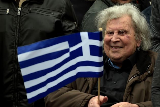 Greek composer Mikis Theodorakis takes part in a demonstration, in Syntagma square in central Athens on February 4, 2018, to urge the government not to compromise in the festering name row with neighbouring Macedonia. / AFP PHOTO / ANGELOS TZORTZINIS (Photo credit should read ANGELOS TZORTZINIS/AFP via Getty Images)