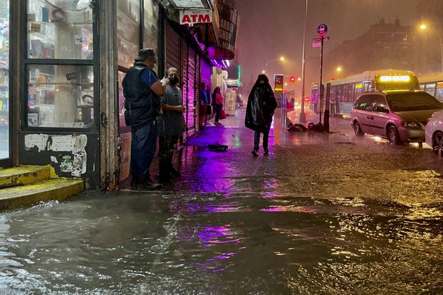 NEW YORK, NY - SEPTEMBER 01: People make their way in rainfall from the remnants of Hurricane Ida on September 1, 2021, in the Bronx borough of New York City. The once category 4 hurricane passed through New York City, dumping 3.15 inches of rain in the span of an hour at Central Park. (Photo by David Dee Delgado/Getty Images)
