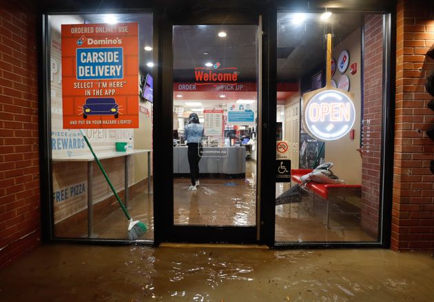HOBOKEN, NJ - SEPTEMBER 1: Floodwaters make their way into a Domino's pizza restaurant caused by the remnants of Hurricane Ida drenching the New York City and New Jersey area on September 1, 2021 in Hoboken, New Jersey. (Photo by Gary Hershorn/Getty Images)