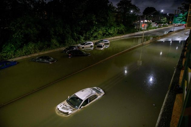 Floodwater surrounds vehicles following heavy rain on an expressway in Brooklyn, New York early on September 2, 2021, as flash flooding and record-breaking rainfall brought by the remnants of Storm Ida swept through the area. (Photo by Ed JONES / AFP) (Photo by ED JONES/AFP via Getty Images)