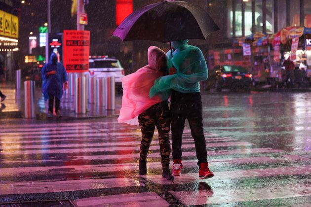 NEW YORK, NY - SEPTEMBER 1: People out in the street during heavy rain and storm at Times Square in New York City, United States on September 1, 2021. Hurricane Ida made landfall in Louisiana on Sunday as a devastating Category 4 hurricane, bringing with it mass flooding and damage. (Photo by Tayfun Coskun/Anadolu Agency via Getty Images)