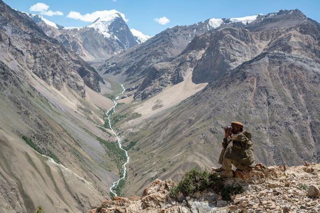 A Wakhi man looks out to the mountains in the Wakhan Corridor of Afghanistan. (Photo by: Tom McShane/Loop...
