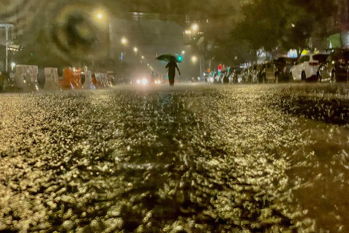 A person makes their way in rainfall from the remnants of Hurricane Ida on Wednesday in the Bronx borough of New York City.