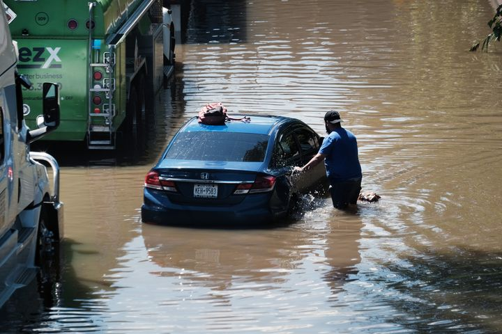 Cars sit abandoned on the flooded Major Deegan Expressway in the Bronx following a night of heavy wind and rain from the remn