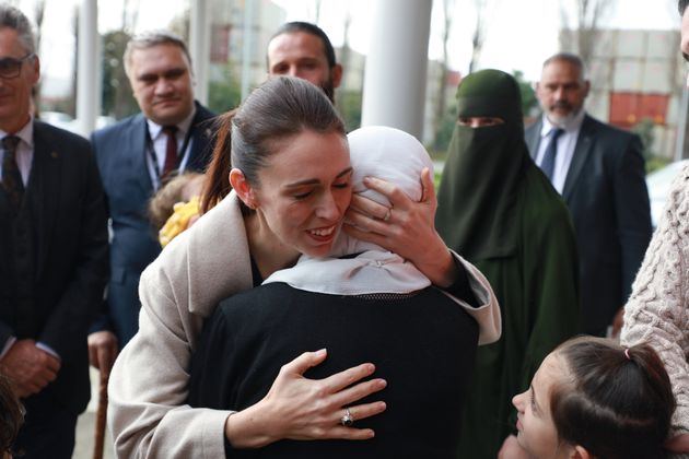 Jacinda Ardern consoling a grieving woman after the 2019