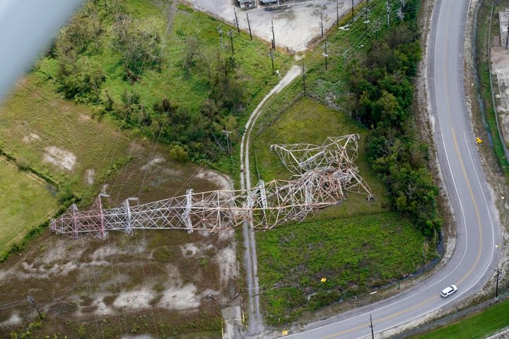 A twisted tower that carried crucial electrical feeder lines to the New Orleans metro area lies collapsed in the aftermath of Hurricane Ida in Bridge City, La.