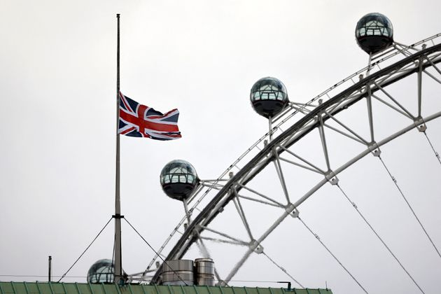 The Union Flag is flown at half-mast from the top of a building on Horse Guards Parade, backdropped by the London Eye, in central London, on April 11, 2021, two days after the death of Britain's Prince Philip, Duke of Edinburgh, at the age of 99. - The funeral of Queen Elizabeth II's husband, Prince Philip, will take place next week, Buckingham Palace said on April 10 , announcing a stripped-back ceremony due to coronavirus restrictions. The Duke of Edinburgh died peacefully on April 9 just two months short of his 100th birthday, triggering eight days of national mourning. (Photo by Tolga Akmen / AFP) (Photo by TOLGA AKMEN/AFP via Getty Images)
