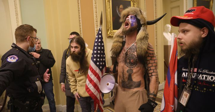 """Jacob Chansley, also known as the """"QAnon Shaman,"""" has pleaded guilty in connection with the Capitol siege."""