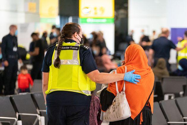 Afghan evacuees arriving at Heathrow Airport in