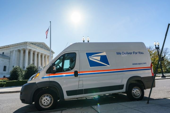 A U.S. Postal Service truck makes deliveries next to the Supreme Court on Election Day, Tuesday, Nov. 3, 2020, in Washington. President Donald Trump says he's planning an aggressive legal strategy to try prevent Pennsylvania from counting mailed ballots that are received in the three days after the election, a matter that could find its way to the high court. (AP Photo/J. Scott Applewhite)