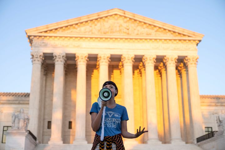 An activist speaks outside the Supreme Court on Sept. 2, 2021, in Washington, D.C., in protest of the new Texas abortion law that prohibits the procedure around six weeks into a pregnancy.