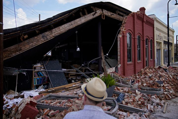 A man looks at a partially collapsed building in the aftermath of Hurricane Ida, Saturday, Sept. 4, 2021, in Houma, Louisiana