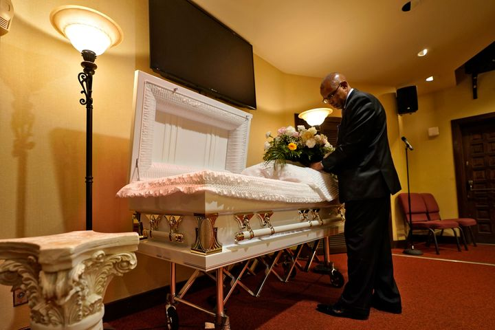 Wayne Bright, funeral director at Wilson Funeral Home, has seen grief piled upon grief during the latest COVID-19 surge. (AP