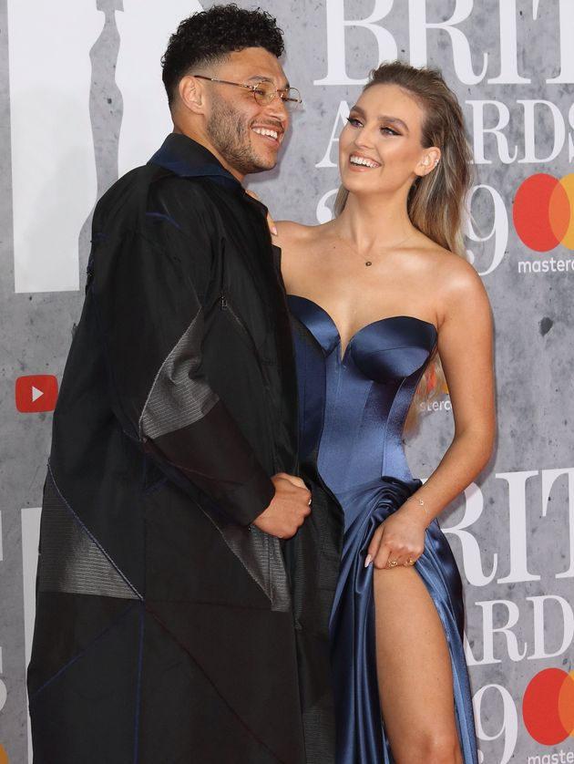 Alex Oxlade-Chamberlain and Perrie Edwards at the 2019 Brit