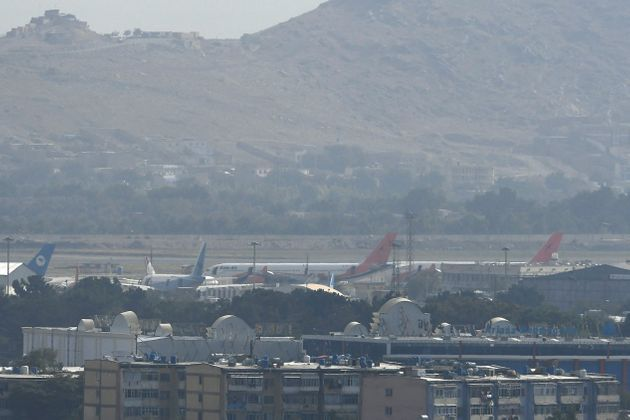 Planes are pictured at the airport in Kabul on August 31, 2021, after the US pulled all its troops out...