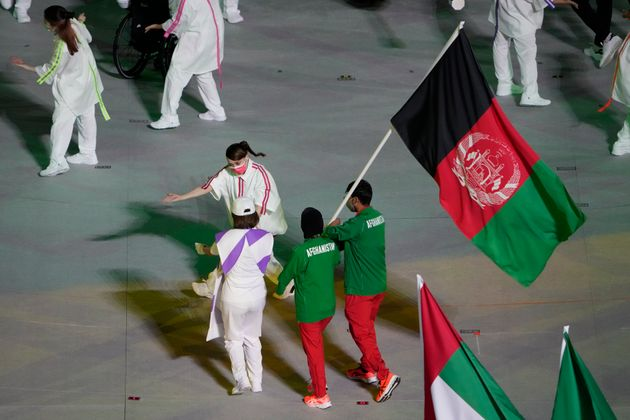 Athletes from Afghanistan march into the stadium during the closing ceremony for the 2020 Paralympics...