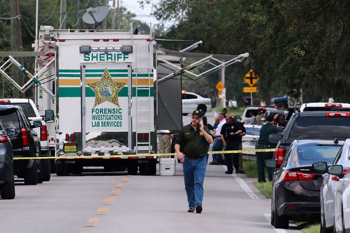 Polk County, Fla., Sheriff's officials work the scene of a multiple fatality shooting Sunday, Sept. 5, 2021, in Lakeland, Florida.