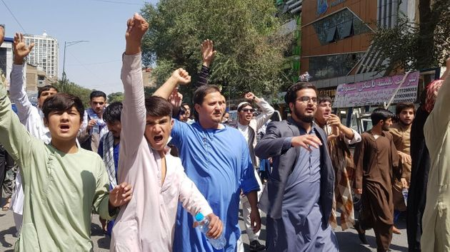 A group of Afghans stage a protest against Pakistan on Tuesday, September