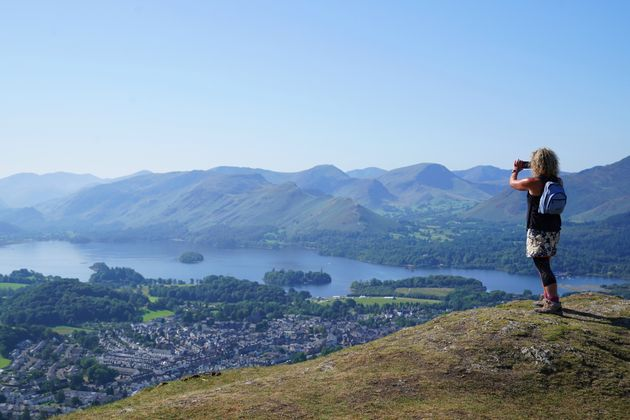 A walker takes in the view of Derwent Water in